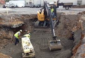 Excavation of foundation on construction site using excavation machine