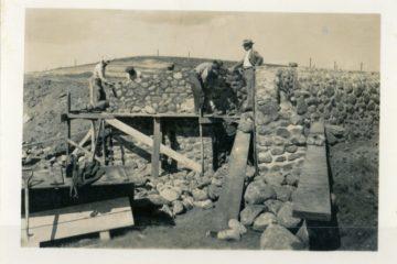 Stone masonry wall construction on site